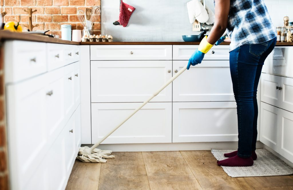 Woman mopping her kitchen floor